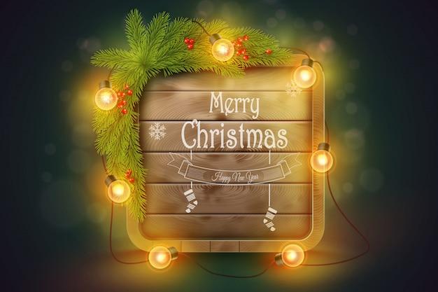 Drewniana tablica świąteczna gałęzie sosnowe, żarówki i życzenia świąteczne.