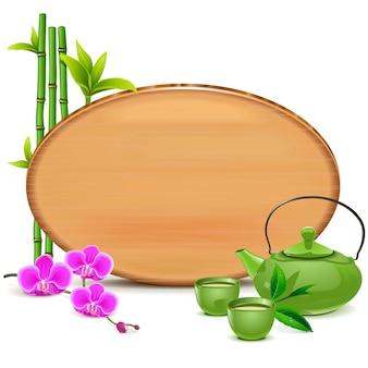 Drewniana tablica z zielonym czajniczkiem na białym tle