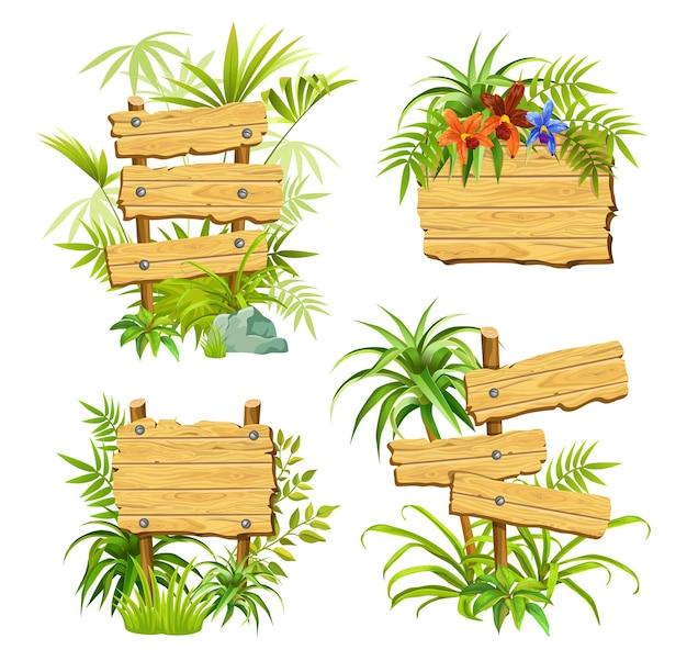 Drewniane deski z zielonymi roślinami z miejscem na tekst.