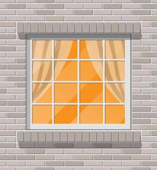 Drewniane klasyczne okno w mur z cegły