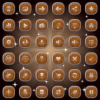 Drewniane kwadratowe przyciski i ikony symboli ze srebrną ramką na białym tle zestaw do gry lub sieci web.