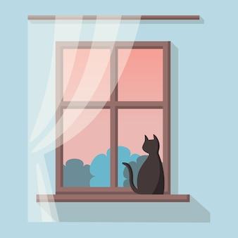 Drewniane okno z widokiem na krajobraz. czarny kot siedzi na parapecie