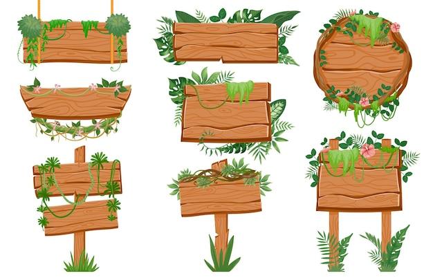 Drewniane szyldy dżungli. drewniana deska z tropikalnymi liśćmi, mchem i roślinami liany do interfejsu gry. kreskówka znaki drogowe na liny wektor zestaw. drewniany sztandar z dżungli, drewniany wskazujący na zielonych liściach ilustracja