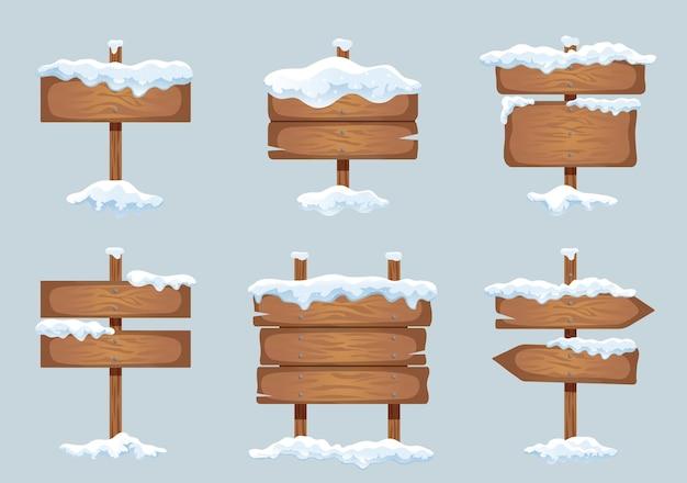 Drewniane szyldy znak kierunkowy tablica wskaźnikowa ze śniegowymi czapami lodowymi realistyczna zima