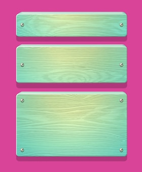 Drewniane talerze, deski, deski z błyszczącymi gwoździami. w kolorach miętowych cukierków.