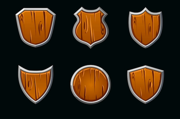 Drewniane tarcze w różnych kształtach. pusty szablon średniowiecznej tarczy.