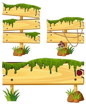 Drewniane znaki z mchu i trawy