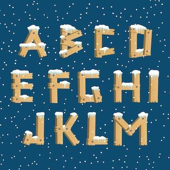 Drewniany alfabet ze śniegiem
