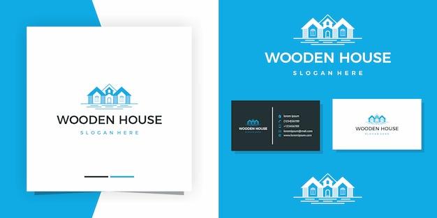 Drewniany dom logo design premium z projektem wizytówki