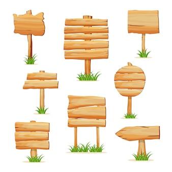 Drewniany drogowskaz w trawie na białym tle zestaw