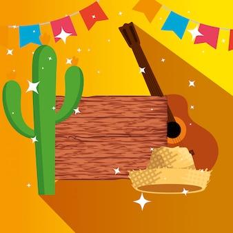 Drewniany emblemat z kaktusową rośliną i kapeluszem