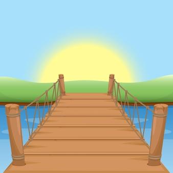 Drewniany most ze słońcem i wodą