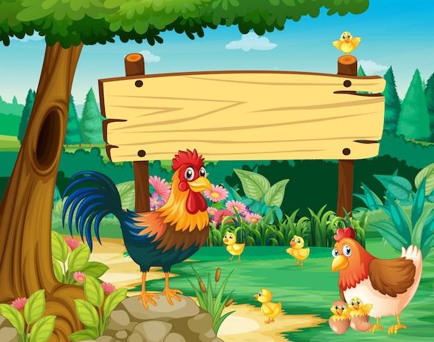 Drewniany znak i kurczaki w parku