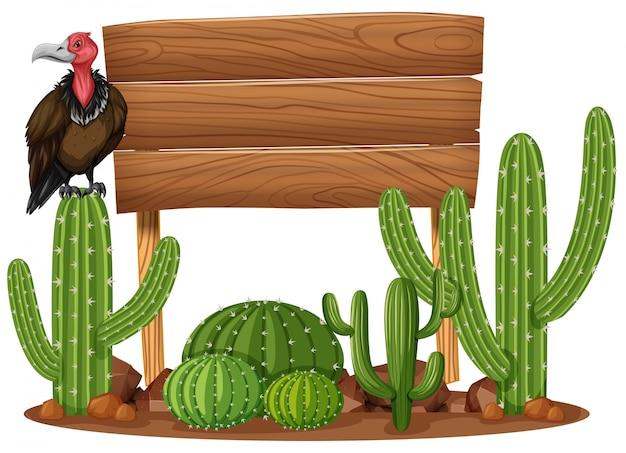 Drewniany znak i sęp w kaktusa ogródzie