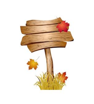 Drewniany znak z jesienną trawą i liśćmi na białym tle.