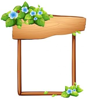 Drewniany znak z kwiatami i liśćmi