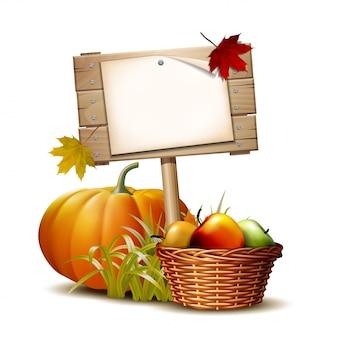 Drewniany znak z pomarańczową dynią, jesiennymi liśćmi i koszem pełnym dojrzałych jabłek. jesienne dożynki lub święto dziękczynienia. warzywa przyjazne dla środowiska.