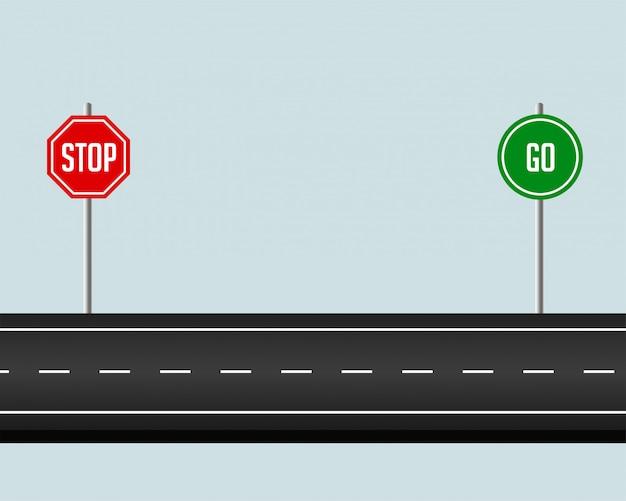 Droga na drodze ze znakiem stop i idź