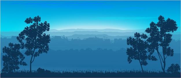 Drzewa w tle przyrody to wzgórza.