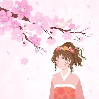 Drzewo kwitnącej wiśni i japonka w kimono