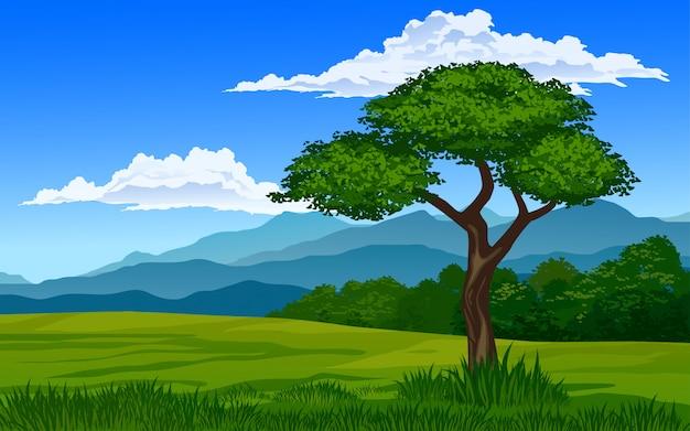 Drzewo na łące z górą