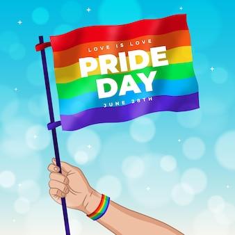 Duma dzień ręki trzymającej flagę