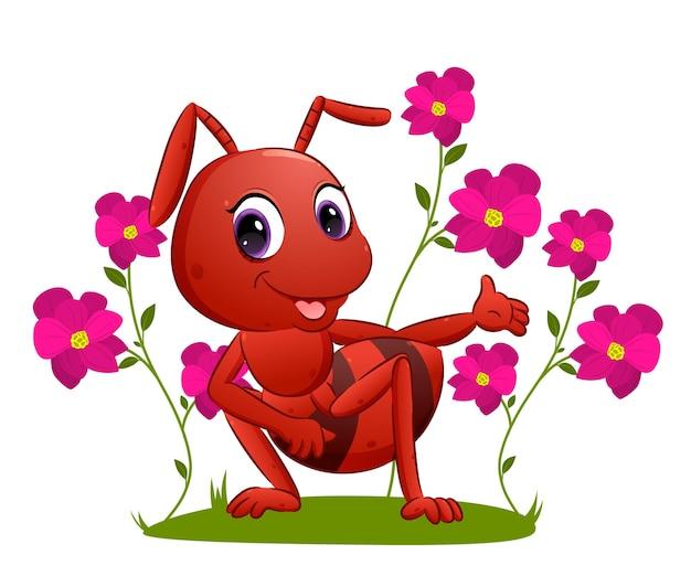 Duża mrówka pokazuje kolorową ilustrację kwiatów