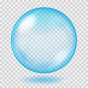 Duża niebieska przezroczysta szklana kula z odblaskami i cieniem.