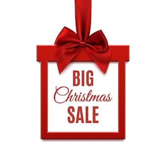Duża świąteczna wyprzedaż, kwadratowy baner w formie prezentu z czerwoną wstążką i kokardą, na białym tle. szablon broszury, karty z pozdrowieniami lub banera.
