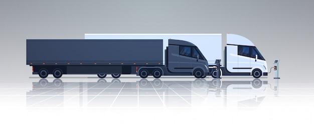 Duże ciężarówki naczepy ciężarówki ładowane na stacji ładowania ładowarki elektrycznej poziome