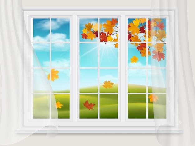 Duże okno z widokiem na jesienny krajobraz.