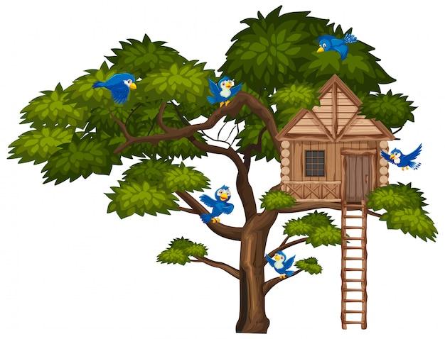 Duże zielone drzewo i wiele niebieskich ptaków latających nad domkiem na drzewie