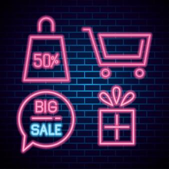 Duży neon sprzedaży na tle cegieł, baner oferty sprzedaży