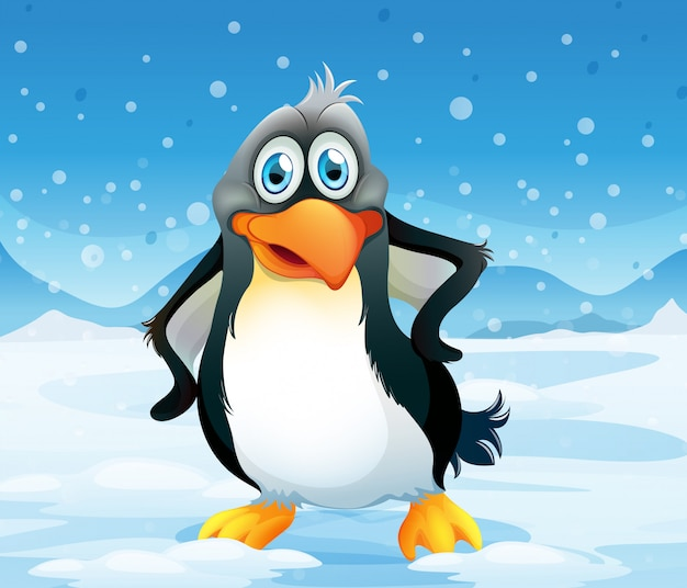 Duży pingwin w zaśnieżonym terenie