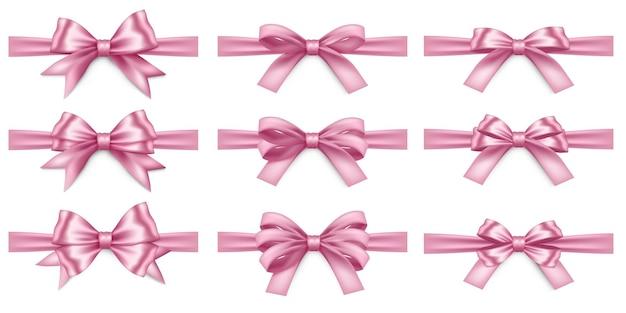 Duży zestaw realistycznych różowych wstążek i kokardek na białym tle