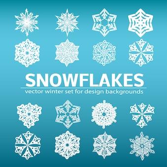 Duży zestaw wektorów płatków śniegu dla prostych zimowych środowisk. na niebieskim tle