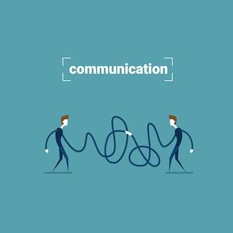 Dwa biznesmen gospodarstwa połączenia przewodowego koncepcja ludzie biznesu komunikacji