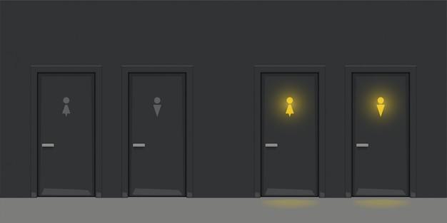 Dwa czarne drzwi wc na czarnej ścianie