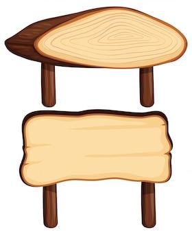 Dwa drewniane znaki na drewnianych słupach