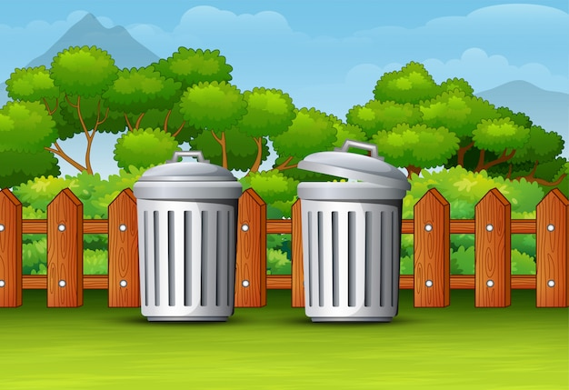 Dwa kosza na śmieci w czystym parku