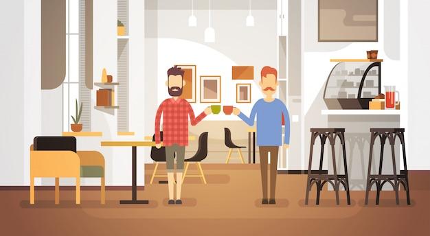 Dwa man drink coffee modern cafe interior restaurant