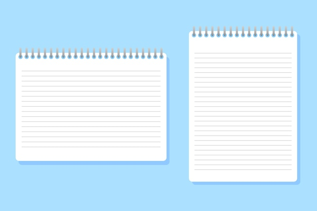 Dwa notebooki o różnych rozmiarach umieszczone na niebiesko
