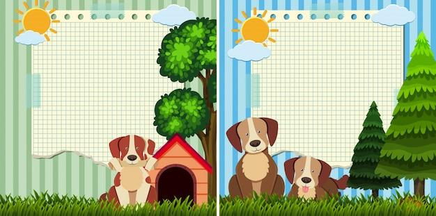 Dwa papierowy szablon z ślicznymi psami w parku