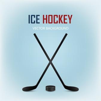 Dwa skrzyżowane kije hokejowe i krążek hokejowy. na białym tle