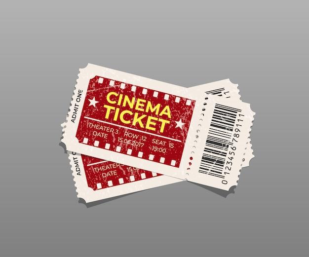 Dwa zabytkowe bilety do kina na białym tle.