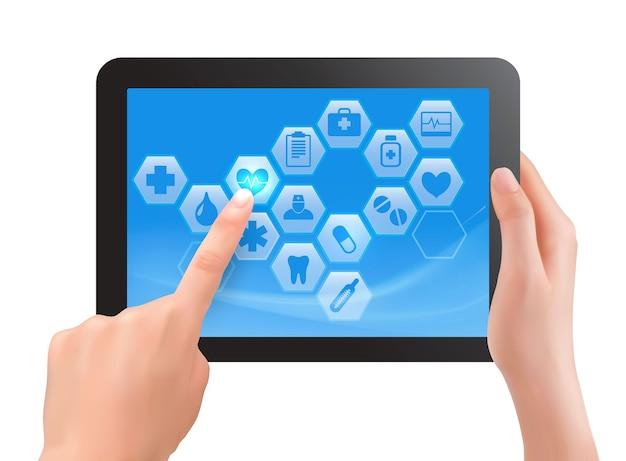 Dwie dłonie dotykają ekranu tabletu z medycznymi ikonami.