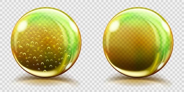 Dwie duże żółte szklane kule z bąbelkami powietrza i bez, z odblaskami i cieniami. przezroczystość tylko w pliku wektorowym
