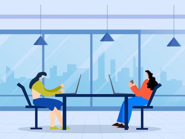 Dwie kobiety bez twarzy za pomocą laptopa i smartfona przy stole z utrzymaniem dystansu społecznego na niebieskim tle.