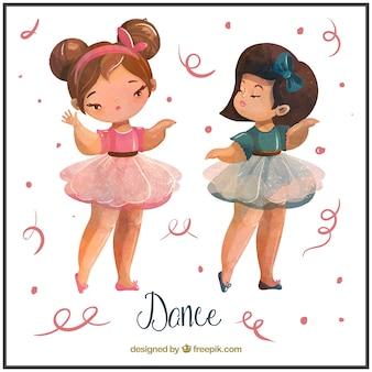 Dwie małe dziewczynki tańczą balet