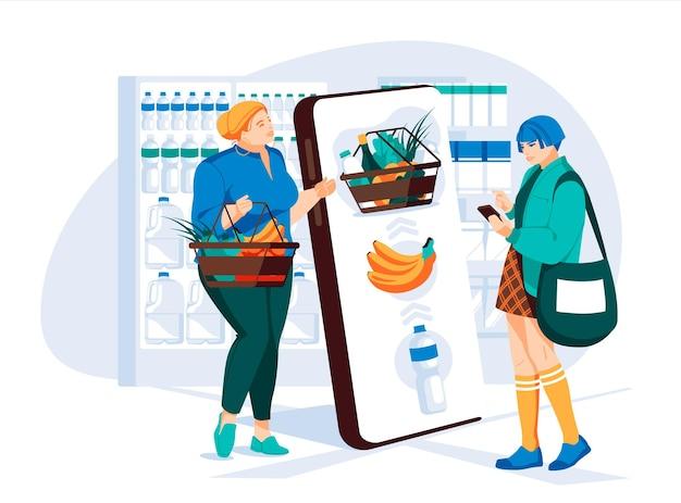 Dwie młode kobiety dokonują wyboru w sklepie spożywczym za pomocą dużego ekranu smartfona witryny sklepowe